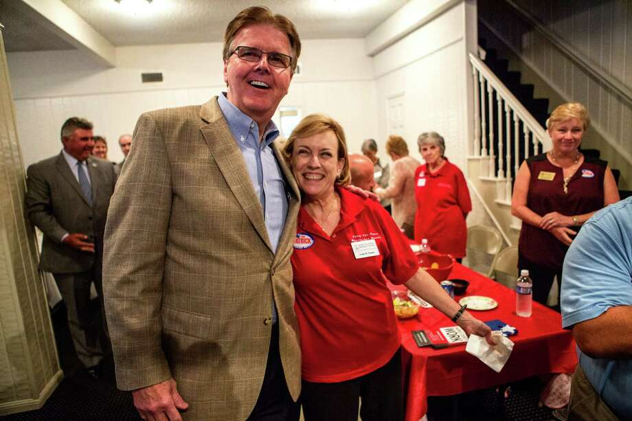 Senator Dan Patrick poses for a photo with supporter, Linda Flower, right, during a Tea Party Republican Women meeting at the Greenwood Forest Residents Club, Tuesday, Sept. 9, 2014, in Houston. (Cody Duty / Houston Chronicle) Photo: Cody Duty, Staff / © 2014 Houston Chronicle