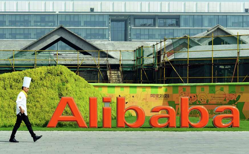 FILE - In this Aug. 27, 2014 file photo, a chef walks in the headquarter campus of Alibaba Group in