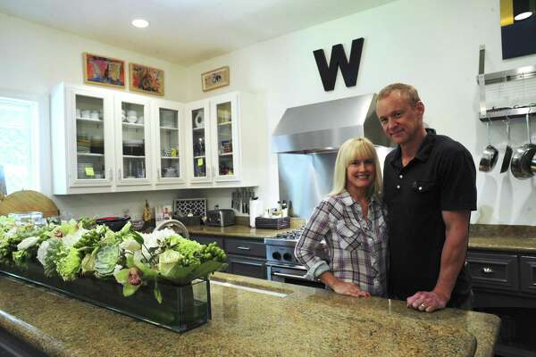 Tracy and Jack Williams focused on family when they redid their kitchen. Some of the framed artwork is by their children.