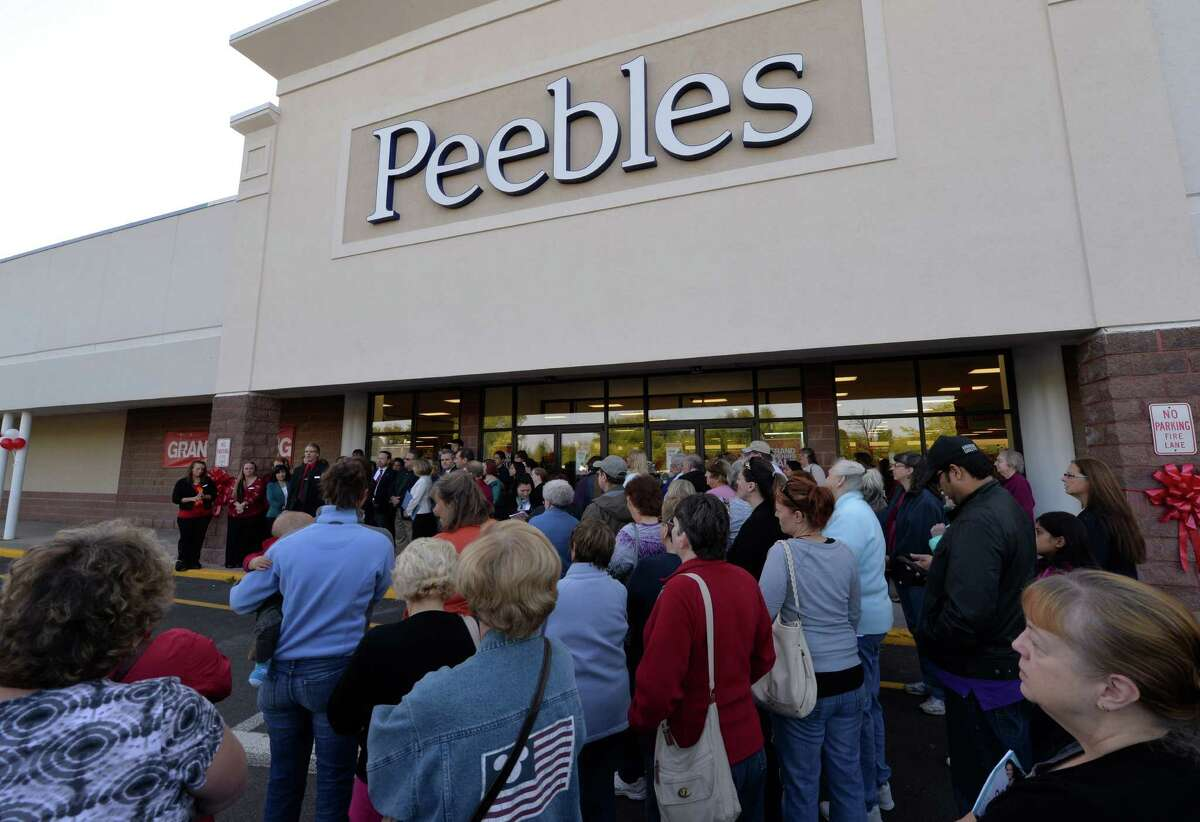 A large crowd wait for the official opening of the Peebles store Thursday morning Sept. 18, 2014 in East Greenbush, N.Y. (Skip Dickstein/Times Union)