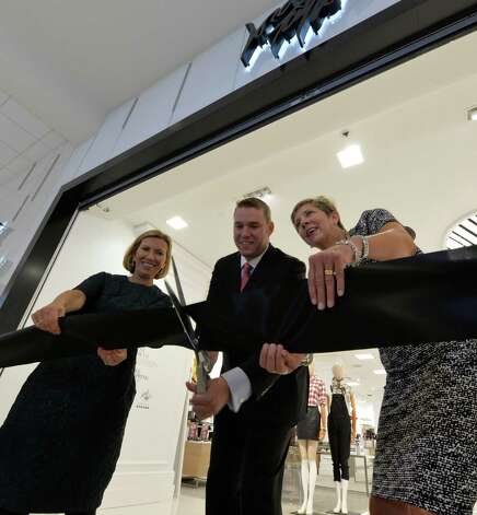 Liz Rodbell, president of Hudson's Bay Co. and Lord & Taylor, left, Greg Powe, general manager of the Crossgates store and Eileen DiLeo, EVP of Hudson's Bay and Lord & Taylor cut the ribbon at the official opening of Lord & Taylor at Crossgates Mall Thursday morning, Sept. 18, 2014, in Guilderland, N.Y.         (Skip Dickstein/Times Union) Photo: SKIP DICKSTEIN / 00028678A
