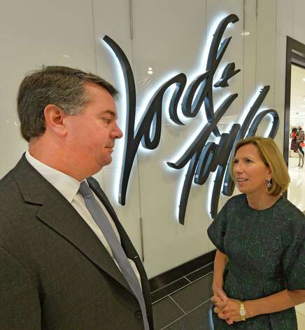 Steve Congel, Pyramid CEO, left, speaks to Liz Rodbell, president of Hudson's Bay Co and Lord and Taylor, on the occasion of the official opening of Lord & Taylor at Crossgates Mall Thursday morning, Sept. 18, 2014 in Guilderland, N.Y. (Skip Dickstein/Times Union) Photo: SKIP DICKSTEIN / 00028678A