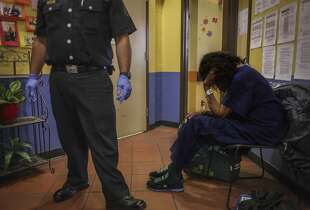 Paramedics prep a resident at Next Door Shelter, a homeless shelter located in the city center, to be taken to the hospital in an ambulance on September 17th 2014. The shelter averages two to three ambulance visits a day. The city center receives the most 911 calls for the entire city.