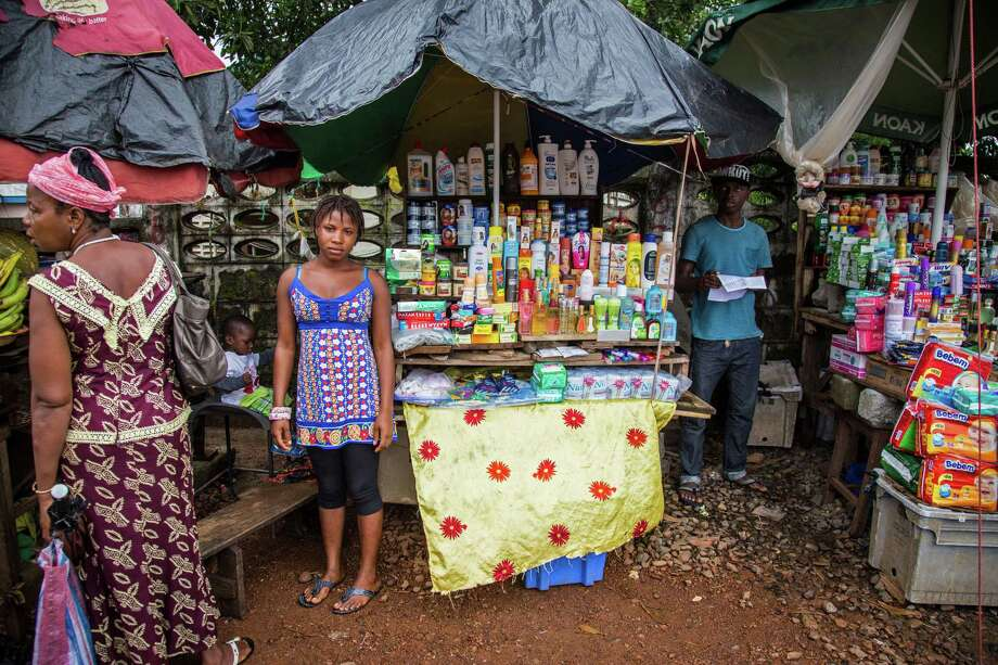 Shoppers in Sierra Leone's capital on Thursday stocking up for a three-day shutdown intended to slow the accelerating spread of the Ebola outbreak. Photo: Michael Duff, STR / AP