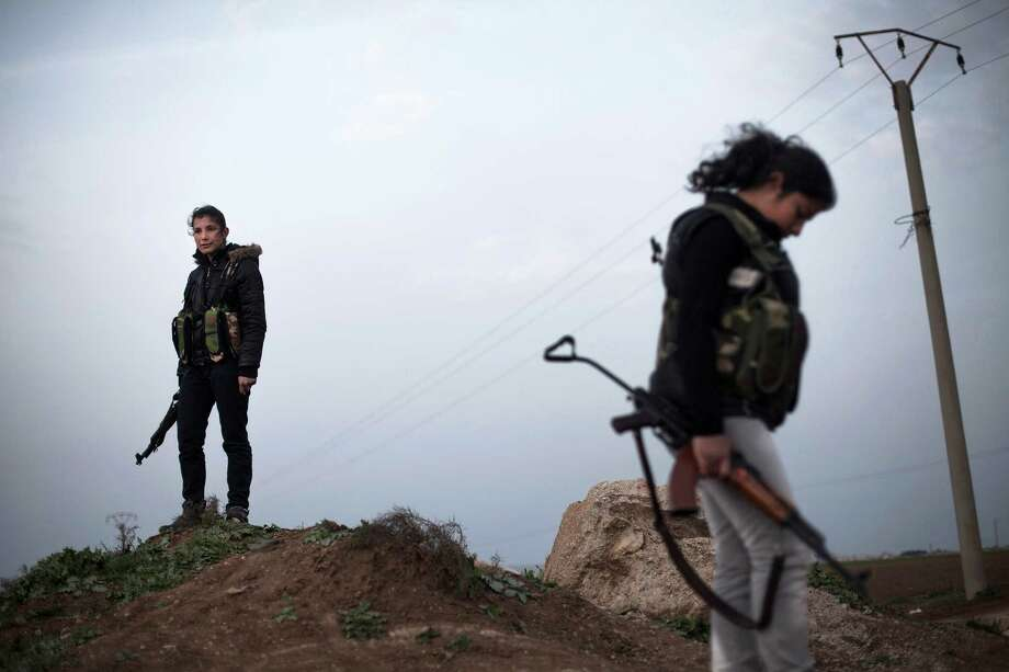 Kurdish forces, including these female guards, are increasingly under pressure from the Islamic State. Photo: Manu Brabo, STR / AP