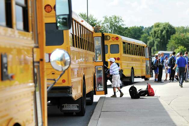 A student loads onto a bus on Thursday, Sept. 18, 2014, at Shaker High in Latham, N.Y. (Cindy Schultz / Times Union) Photo: Cindy Schultz