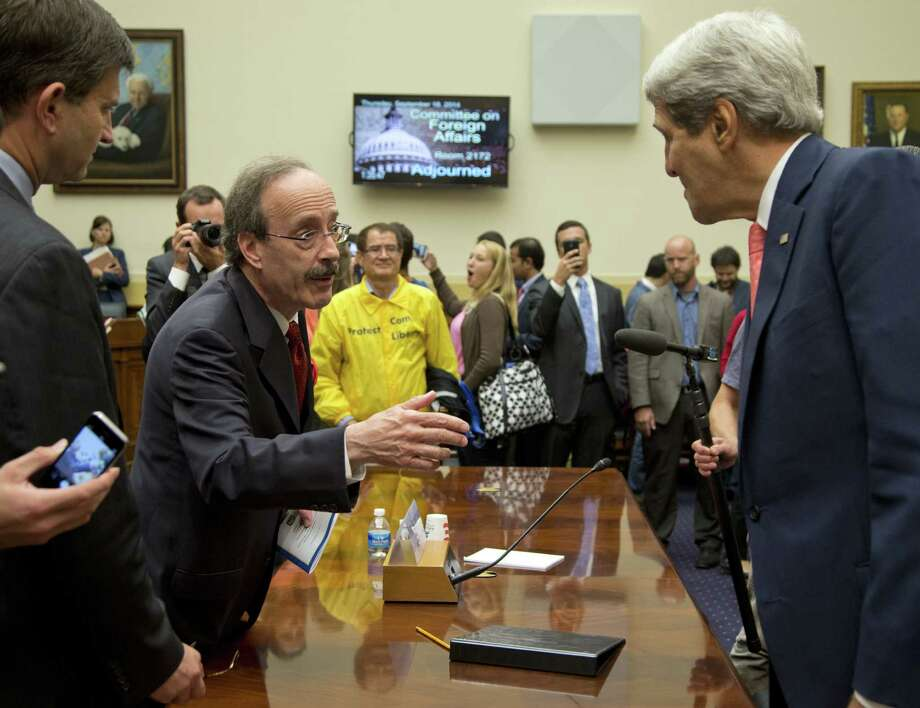 Secretary of State John Kerry speaks with Rep. Eliot Engel, D-N.Y., ranking member of the House Foreign Affairs Committee. Photo: Carolyn Kaster / Associated Press / AP