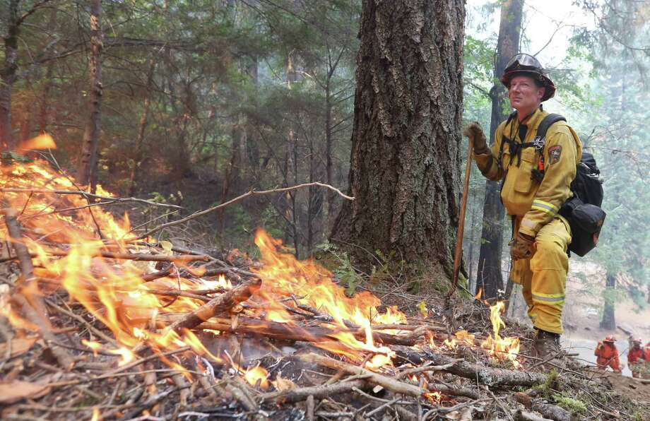 Capt. Larry Turman of the California Department of Forestry and Fire Protection watches a fire containment line set near Fresh Pond, Calif. Photo: Rich Pedroncelli, STF / AP