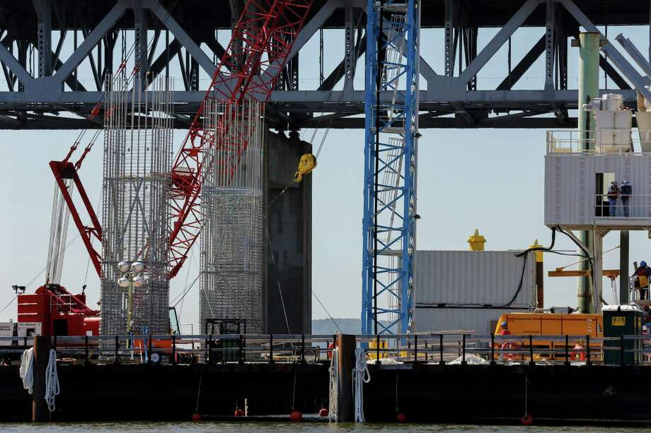 A construction site for the Tappan Zee Bridge in Tarrytown, N.Y., Sept. 9, 2014. Less than a year after construction began, the first major bridge to be built in the New York City area in half a century has progressed toward its planned openings: The first span, for two-way traffic, is to be completed in December 2016, and the full bridge by 2018. (Angel Franco/The New York Times) ORG XMIT: XNYT68 Photo: ANGEL FRANCO / NYTNS