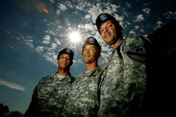 Army 1st Sgt. Allen Mouton, left, and his brothers, Sgt. Reginald Mouton and 1st Sgt. Michael Mouton stand together on Sept. 14, 2006, at Fort Hood.