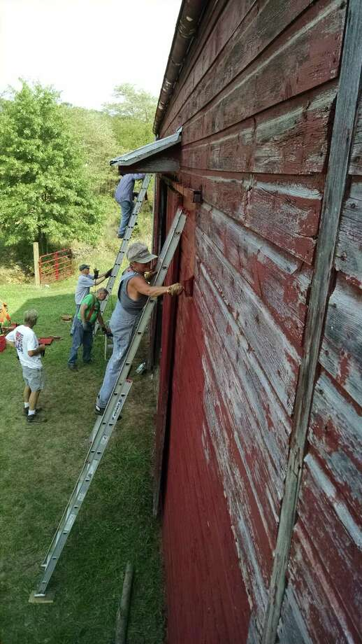 Volunteers from The New Baltimore Conservancy put the finishing touches on the restored Bronk/Armstrong barn that is the gateway to Scenic Hudson's Long View Park.  The grand opening event is from 2 to 9 PM on September 20 and is free and open to the public. (Janet Angelis)