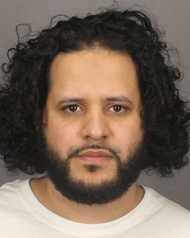 FILE- In this June 2, 2014, file photo provided by the Monroe County Sheriff's Office Mufid Elfgeeh, of Rochester, N.Y., is shown. Elfgeeh, who was accused of plotting to kill members of the U.S. military and others, is now facing new charges that he tried to aid the Islamic State group in Syria and Iraq. (AP Photo/Monroe County Sheriff's Office, File) ORG XMIT: NYR102 / Monroe County Sheriff's Office
