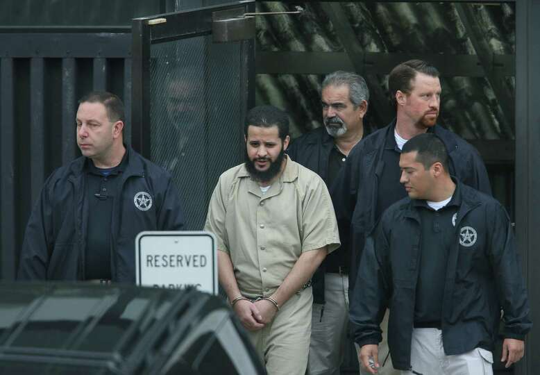Mufid Elfgeeh is taken out of Federal Court in Rochester, N.Y. on Thursday, Sept.  18 2014.  Elfgeeh