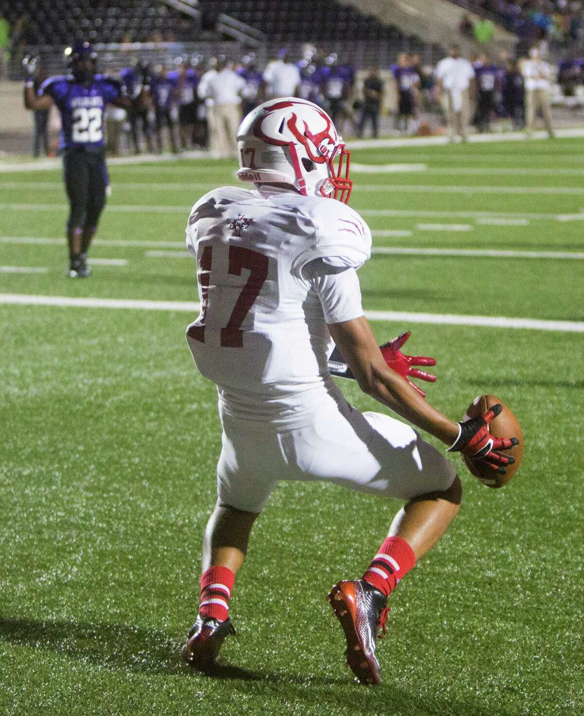 Crosby's Shane Hudson drops a pass in the end zone during the first half of a football game against Humble, at Turner Field, Thursday, Sept. 18, 2014, in Humble.