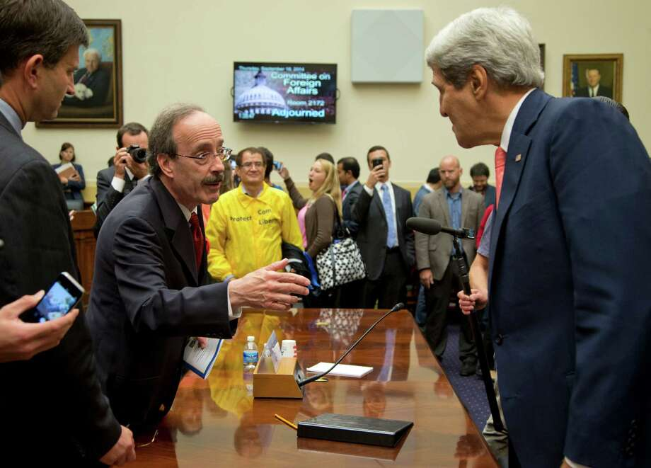 Secretary of State John Kerry, right, speaks with House Foreign Affairs Committee ranking member Rep. Eliot Engel, D-N.Y., on Capitol Hill in Washington, Thursday, Sept. 18, 2014, after a House Foreign Affairs Committee hearing. At the hearing, Kerry sought to push back on an argument by some in Congress that Syria's rebels lack moderates, or at least any with the capacity to make a difference in the war. (AP Photo/Carolyn Kaster) ORG XMIT: DCCK112 Photo: Carolyn Kaster / AP