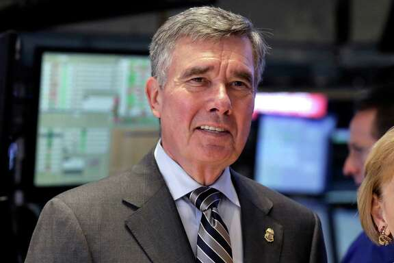 "FILE - U.S. Customs and Border Protection Commissioner R. Gil Kerlikowske poses for photos after ringing the New York Stock Exchange closing bell, Tuesday, Aug. 5, 2014 file photo. Kerlikowske scheduled a news conference Thursday Sept. 18, 2014 in Washington to discuss what his office said were ""developments toward CBP's commitment to increase transparency and accountability."" (AP Photo/Richard Drew, File)"