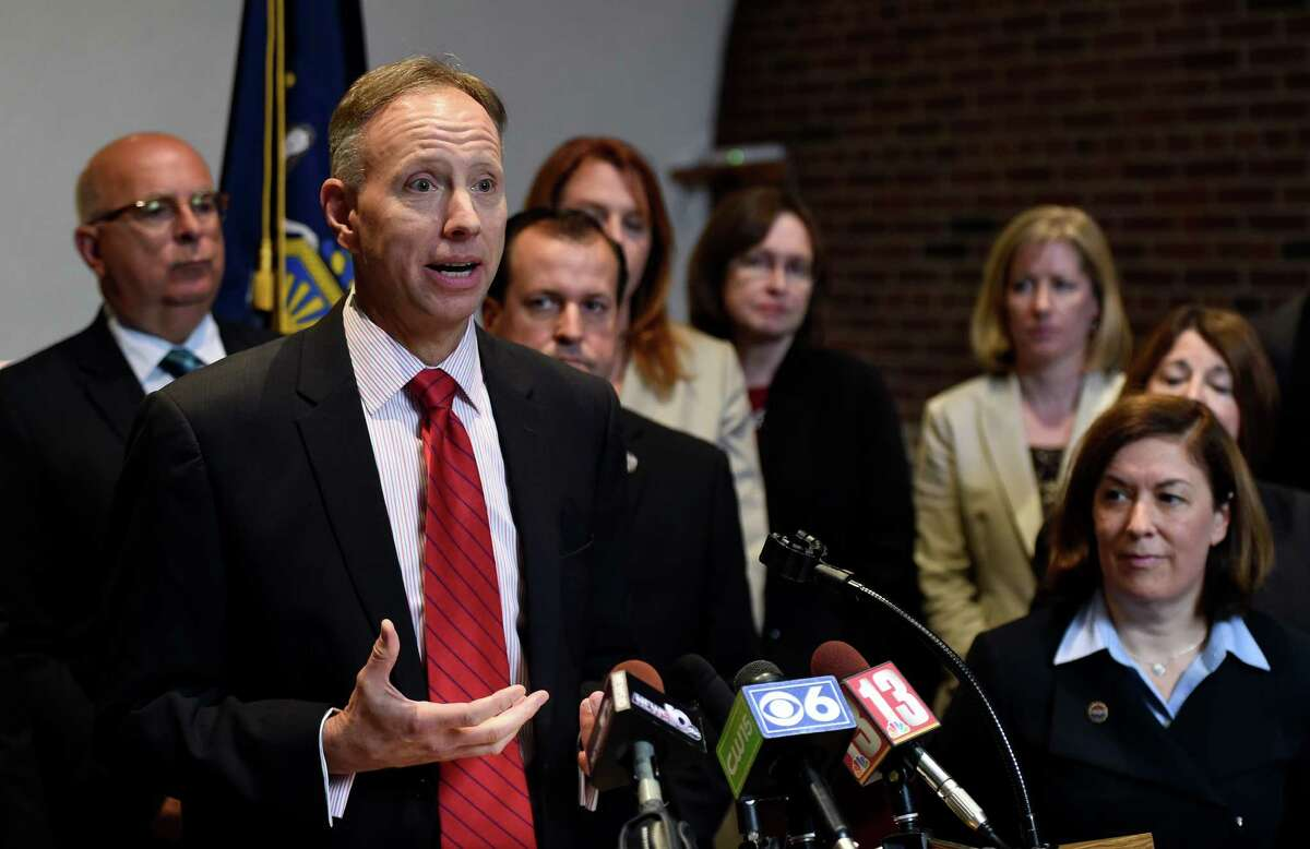 Saratoga County District Attorney Jim Murphy, left, announced he will step down and place Karen Heggen, right, in his position as acting DA Thursday, Sept. 18, 2014, during a press conference held at Murphy's office in Ballston Spa, N.Y. (Skip Dickstein/Times Union)