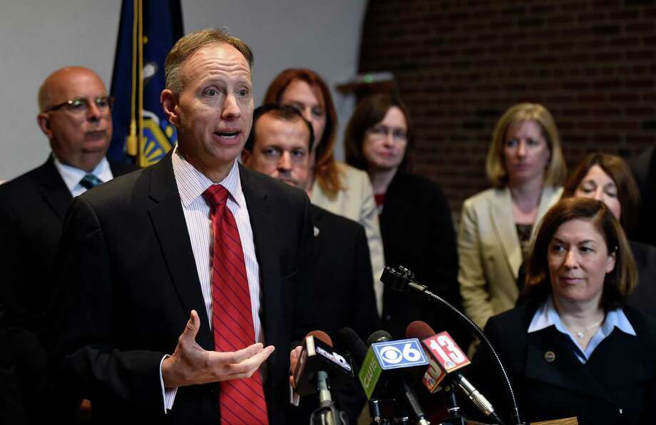 Saratoga County District Attorney Jim Murphy, left, announced he will step down and place Karen Heggen, right, in his position as acting DA Thursday, Sept. 18, 2014, during a press conference held at Murphy's office in Ballston Spa, N.Y.  (Skip Dickstein/Times Union) Photo: SKIP DICKSTEIN / 00028666A