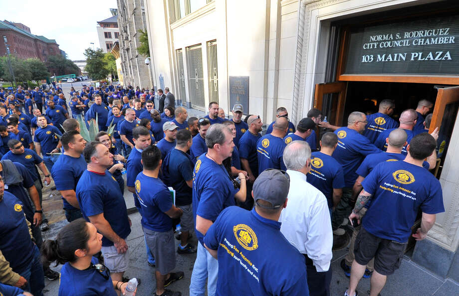 Members of the San Antonio Police Officers Association and the San Antonio Professional Fire Fighters Association file into council chambers beforethe budget meeting. Photo: Robin Jerstad / For The San Antonio Express-News