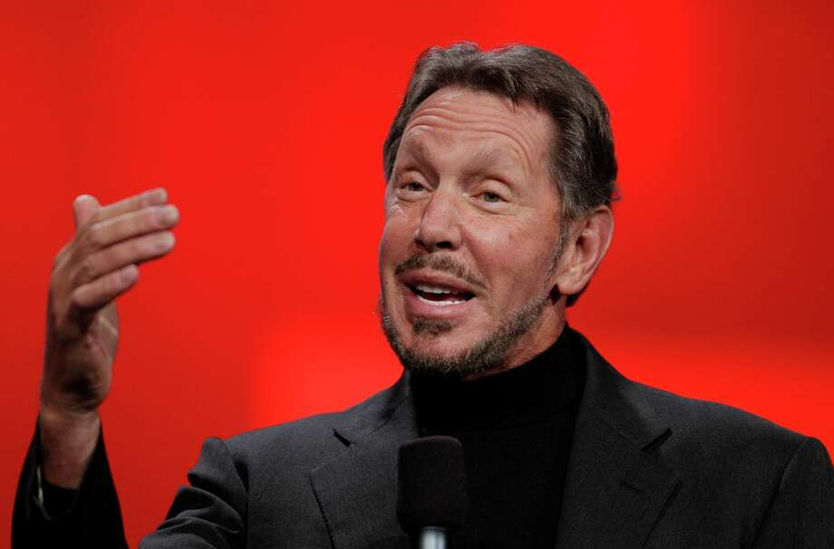FILE - In this Oct. 2, 2012 file photo, Oracle CEO Larry Ellison gestures while giving a keynote address at Oracle OpenWorld in San Francisco. Oracle says Ellison is stepping aside as CEO of the company he founded. The business software maker promoted Safra Catz and Mark Hurd to replace him as co-CEOs. (AP Photo/Eric Risberg, File) Photo: Eric Risberg, STF / AP