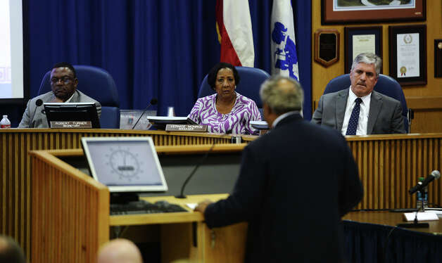 Secretary Robert Turner, and managers Vernice Butler and Jack Carroll, left to right, listen to public commentary during Thursday's meeting. The Beaumont Independent School District board of managers met Thursday night for their regular meeting. Photo taken Thursday 9/18/14 Jake Daniels/@JakeD_in_SETX Photo: Jake Daniels / ©2014 The Beaumont Enterprise/Jake Daniels