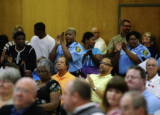 Employees of the BISD Police Department applaud comments by Chief Clydell Duncan during Thursday night's board of managers meeting. The Beaumont Independent School District board of managers met Thursday night for their regular meeting. Photo taken Thursday 9/18/14 Jake Daniels/@JakeD_in_SETX Photo: Jake Daniels / ©2014 The Beaumont Enterprise/Jake Daniels