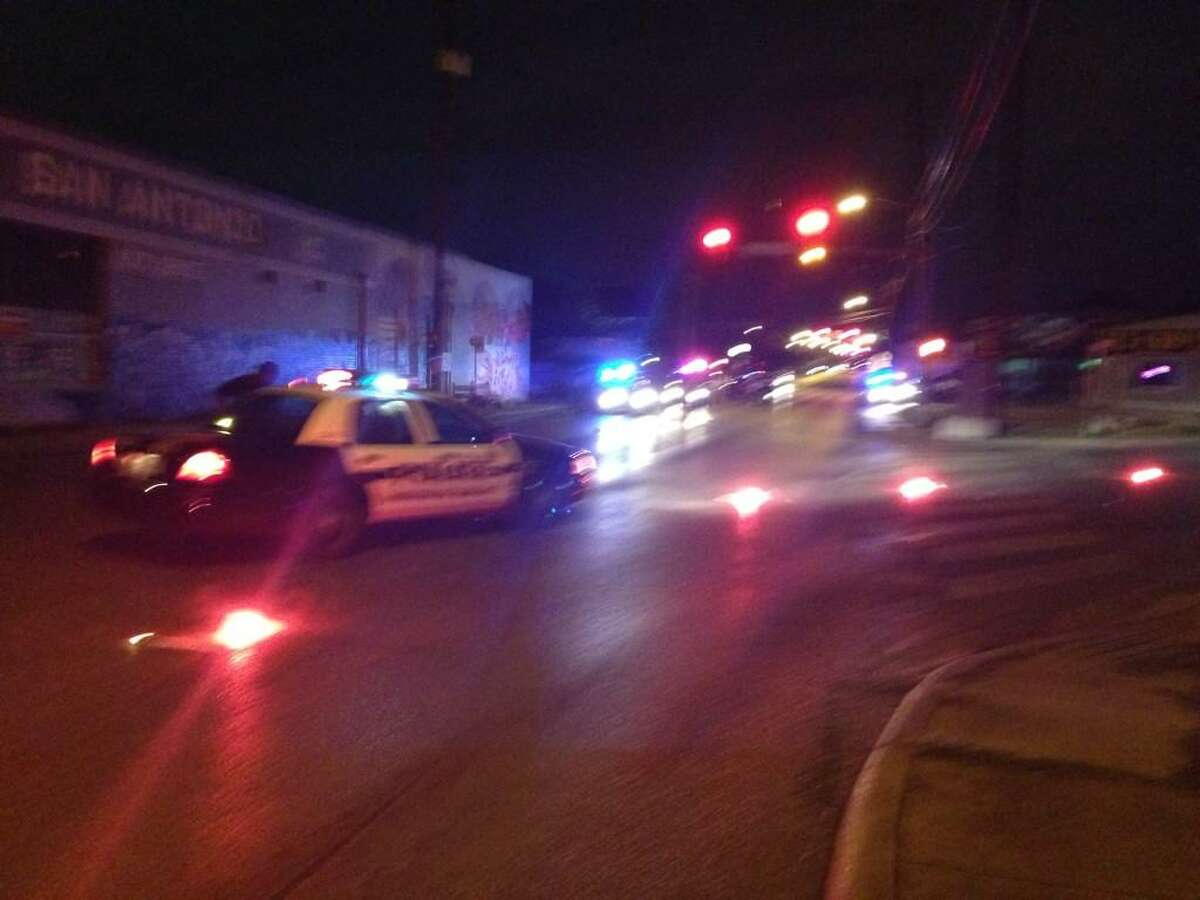 San Antonio Police work the scene of a hit-and-run accident at Fredericksburg and Blanco Roads on Thursday, Sept. 18, 2014. A pedestrian in his 40s was struck by a red vehicle that fled the scene, police said.