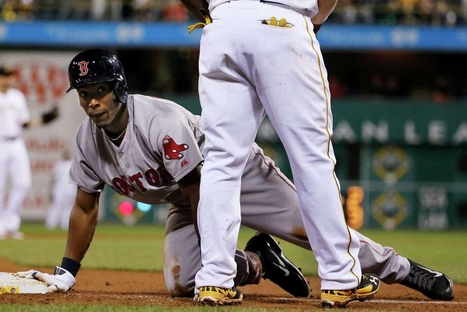 Boston Red Sox's Jemile Weeks gets up after being called out for being hit by a ground ball down the third baseline by Boston's Will Middlebrooks during the ninth inning of a baseball game against the Pittsburgh Pirates in Pittsburgh Thursday, Sept. 18, 2014. The Pirates won 3-2. (AP Photo/Gene J. Puskar) ORG XMIT: PAGP117 Photo: Gene J. Puskar / AP