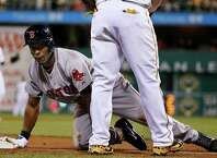 Boston Red Sox's Jemile Weeks gets up after being called out for being hit by a ground ball down the third baseline by Boston's Will Middlebrooks during the ninth inning of a baseball game against the Pittsburgh Pirates in Pittsburgh Thursday, Sept. 18, 2014. The Pirates won 3-2. (AP Photo/Gene J. Puskar) ORG XMIT: PAGP117