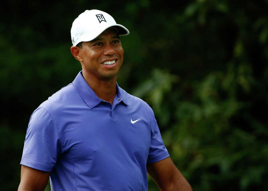 LOUISVILLE, KY - AUGUST 07:  Tiger Woods of the United States smiles on the 18th tee during the first round of the 96th PGA Championship at Valhalla Golf Club on August 7, 2014 in Louisville, Kentucky.  (Photo by Sam Greenwood/Getty Images) ORG XMIT: 461915425 Photo: Sam Greenwood / 2014 Getty Images
