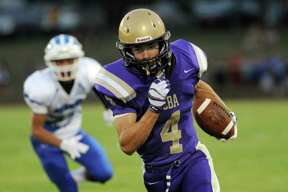 CBA's Ben Anthony, right, runs the ball on his way to a touchdown during their football game against Shaker on Friday, Sept. 5, 2014, at Christian Brothers Academy in Colonie, N.Y. (Cindy Schultz / Times Union) Photo: Cindy Schultz / 00028436A