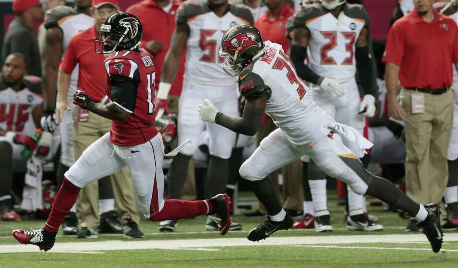 Atlanta Falcons wide receiver Devin Hester (17) runs by Tampa Bay Buccaneers free safety Keith Tandy (37) during the first half of an NFL football game, Thursday, Sept. 18, 2014, in Atlanta. (AP Photo/John Bazemore) ORG XMIT: GAMS106 Photo: John Bazemore / AP