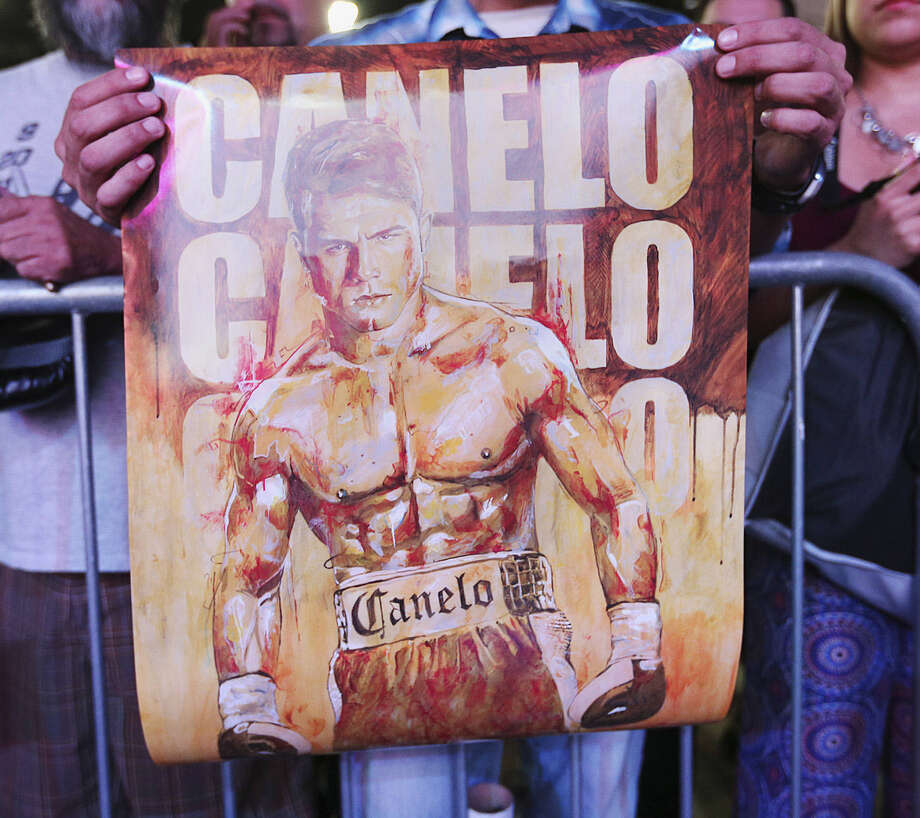 """A Saul """"Canelo"""" Alvarez fan, one of many in S.A., holds a poster of the boxer before a Convention Center appearance. Photo: Jerry Lara / San Antonio Express-News / @San Antonio Express-News"""