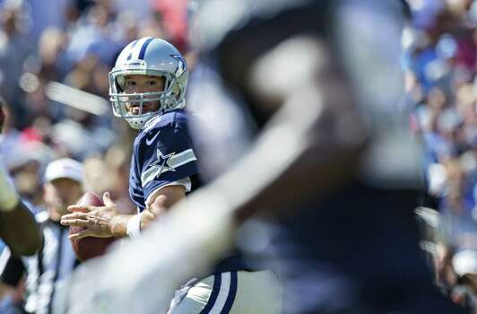 Tony Romo says he's 100 percent, that he's throwing the ball better than ever, but the Cowboys' balanced-offense emphasis means less pressure for a 34-year-old coming off back surgery. Photo: Wesley Hitt / Getty Images / 2014 Getty Images