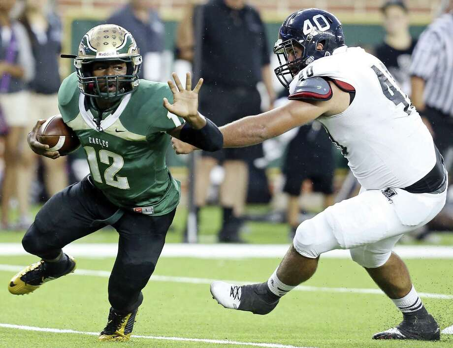 DeSoto's Jaylin Nelson looks for room to run as Steele's Zach Edwards pursues during the first half of the second-ranked Eagles' victory over the fourth-ranked Knights at Baylor's McLane Stadium. Photo: Edward A. Ornelas / San Antonio Express-News / © 2014 San Antonio Express-News