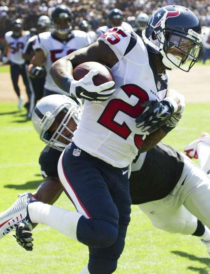 Texans cornerback Kareem Jackson returns an interception against the Raiders on Sunday. Photo: Brett Coomer / Houston Chronicle / © 2014  Houston Chronicle