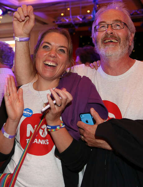 Better Together campaigners celebrate early poll results at a party in Glasgow, Scotland. Photo: Peter Macdiarmid / Getty Images / 2014 Getty Images