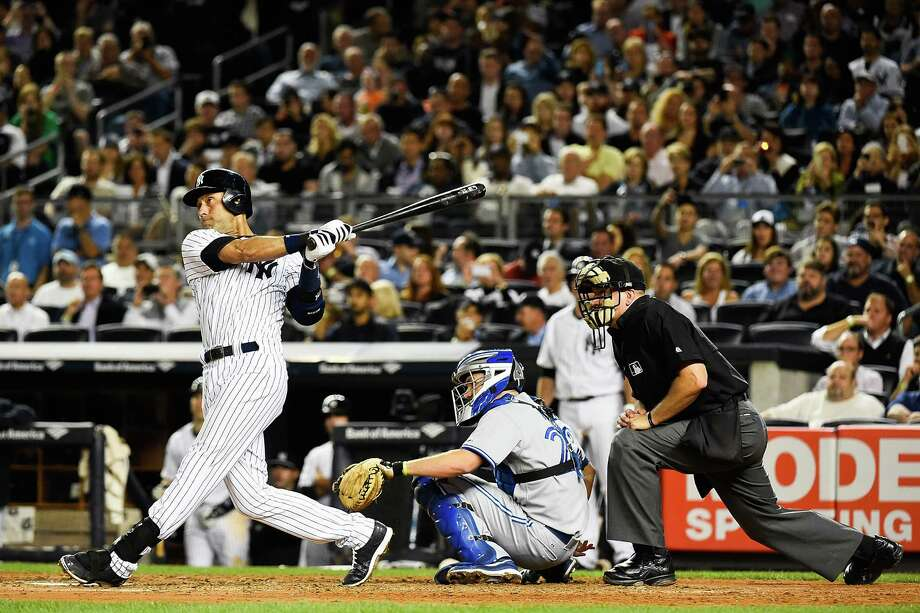Yankees captain Derek Jeter provided a lift with a solo home run in the sixth inning, helping New York beat Toronto 3-2 to keep its playoff hopes alive. Photo: Alex Goodlett, Stringer / 2014 Getty Images