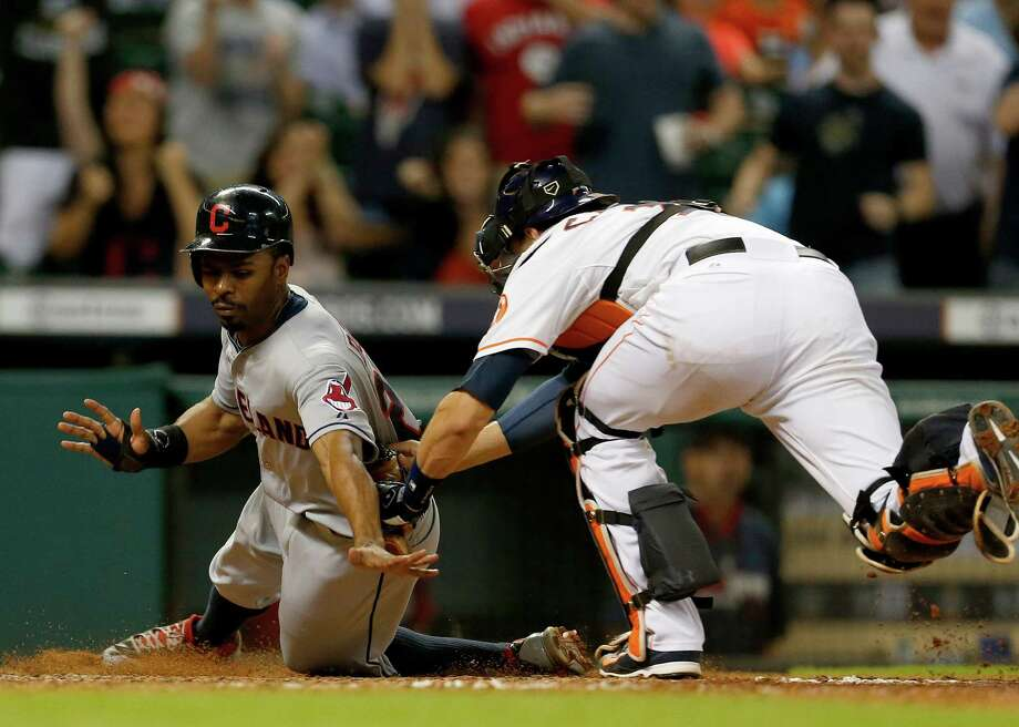 Cleveland Indians center fielder Michael Bourn (24) is tagged out at home by Houston Astros catcher Jason Castro (15) in the ninth inning of an MLB baseball game at Minute Maid Park, Thursday, Sept. 18, 2014, in Houston. ( Karen Warren / Houston Chronicle  ) Photo: Karen Warren, Staff / © 2014 Houston Chronicle