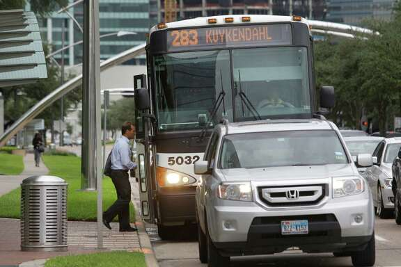 A passenger boards a Metro bus along Post Oak near Westheimer Thursday, Sept. 18, 2014, in Houston.