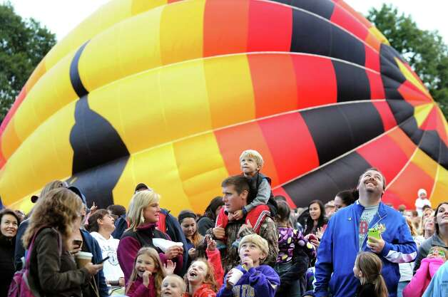 The Aussie Heir balloon fills with air as spectators watch the action during the 42nd annual Adirondack Balloon Festival on Thursday, Sept. 18, 2014, at Crandall Park in Glens Falls, N.Y. (Cindy Schultz / Times Union) Photo: Cindy Schultz / 00028662A