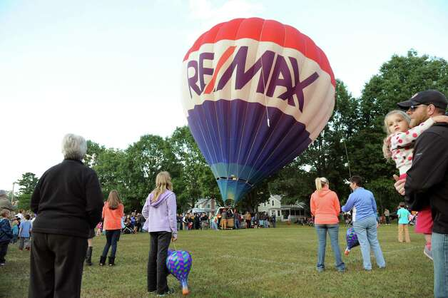The Re/Max balloon rises during the 42nd annual Adirondack Balloon Festival on Thursday, Sept. 18, 2014, at Crandall Park in Glens Falls, N.Y. (Cindy Schultz / Times Union) Photo: Cindy Schultz / 00028662A