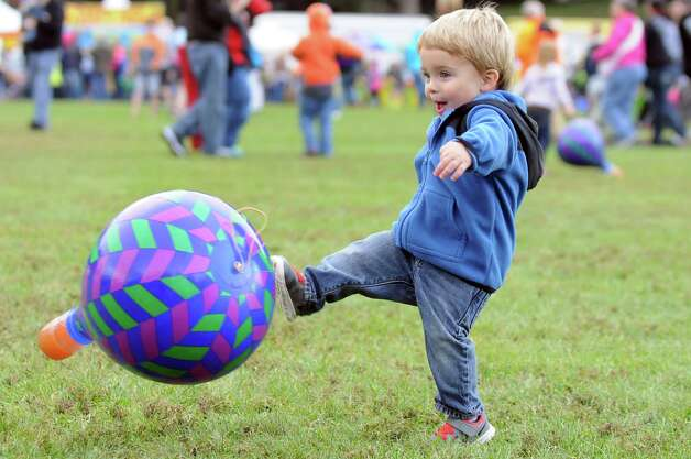 Cove Baker, 20 months, of South Glens Falls kicks an inflatable toy hot-air balloon during the 42nd annual Adirondack Balloon Festival on Thursday, Sept. 18, 2014, at Crandall Park in Glens Falls, N.Y. (Cindy Schultz / Times Union) Photo: Cindy Schultz / 00028662A