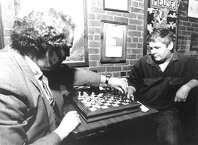 Chess players Bill Dykstra and Ivan Capin ponder their strategies during a game night at the former Apple's Cafe on Atlantic Street in downtown Stamford on Sept. 25, 1989.
