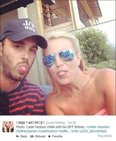 A photo shows Britney Spears and Texan Cade Hudson, friend of Spears' ex-fiancé Jason Trawick, stic