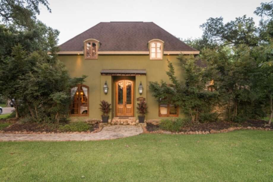 Located at 1801 Nall Street in Port Neches, this home has 4 bedrooms and 4 bathrooms for a total of 3,673 square feet. It is listed at $525,000. Photo: Zillow