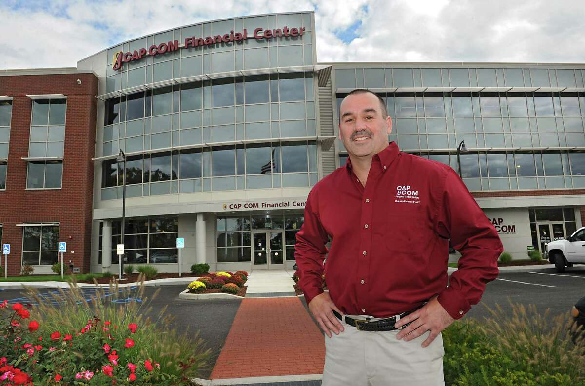 Chris McKenna of CAP COM stands in front of the CAP COM Federal Credit Union building on Tuesday, Sept. 16, 2014 in Colonie, N.Y. (Lori Van Buren / Times Union)