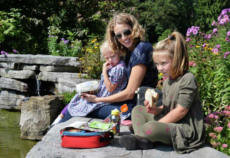 Alyssia Cursi of Niskayuna picnics with her daughter Willow Cursi, 4, left, and their neighbor Kaitlin Neugebauer, 4, in the Central Park Rose Garden Thursday Sept. 18, 2014, in Schenectady, NY.  (John Carl D'Annibale / Times Union) Photo: John Carl D'Annibale