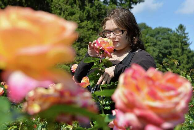 Jessica Bowie of Schenectady breathes in the sweet smell of a rose at the Central Park Rose Garden Thursday Sept. 18, 2014, in Schenectady, NY.  (John Carl D'Annibale / Times Union) Photo: John Carl D'Annibale