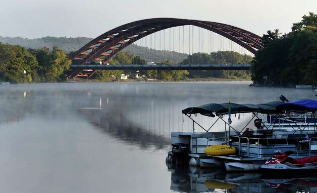 A fine mist hovers over the waters of the Mohawk River under the I-87 twin bridges due to the cool temperatures Thursday morning Sept. 18, 2014 in Colonie, N.Y.    (Skip Dickstein/Times Union) Photo: SKIP DICKSTEIN / 00028645A